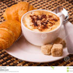 http://www.dreamstime.com/royalty-free-stock-photography-cup-coffee-bun-cake-image29113287